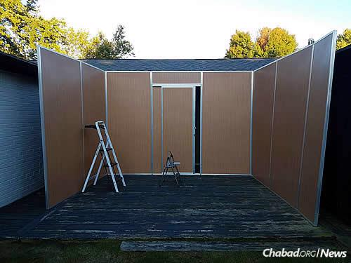 The Dubov sukkah in the works before the start of the holiday