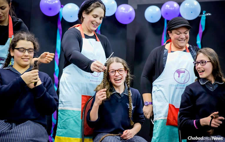 About 150 girls at Beth Rivkah Ladies College—a Chabad school in Melbourne, Australia—grew their hair out over the course of a year so that it could be cut and made into wigs for child cancer patients. The tresses will go to Zichron Menachem, an Israeli nonprofit charity. (Photo: Chana Franck)
