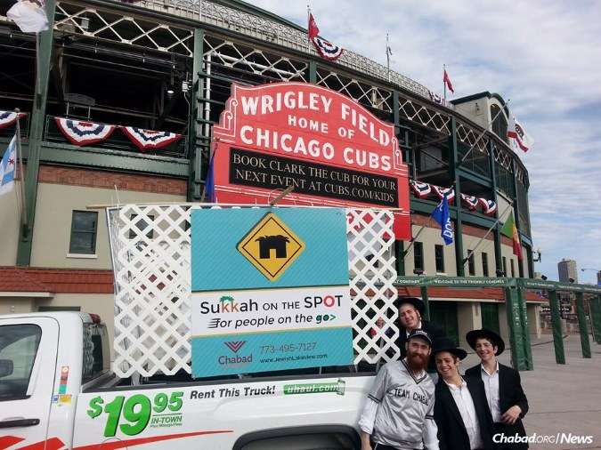 Rabbi Dovid Kotlarsky, left, has been stationing himself around Wrigley Field with mitzvahs in tow.