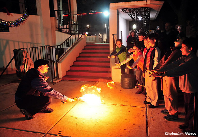 Children in Mobile, Ala., are looking forward to Chanukah again this year. Above, a performance at the Southern city's first public menorah-lighting, organized two years ago by Rabbi Yosef and Bina Goldwasser, co-directors of the Chabad House there.