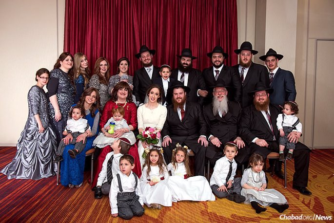 The extended Litvin family has lived and worked in the state of Kentucky for more than 30 years. Here, they celebrate the marriage of Sheina Litvin to Rabbi Yanki Biggs; the couple is moving back to Louisville to serve the Jewish community there. (Photo: Elisheva Golani)