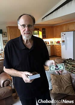 Before leaving to live his last weeks in Washington, David displays a Tanya printed in Alaska, as well as a dollar that had been given by the Lubavitcher Rebbe.