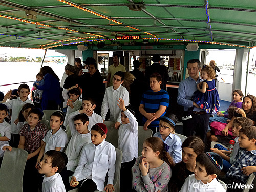 Children from Maimonides, some with family members along, enjoy a Chanukah cruise.