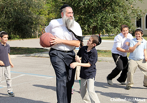 Rabbi Minkowicz has possession of the ball and goes for a shot …