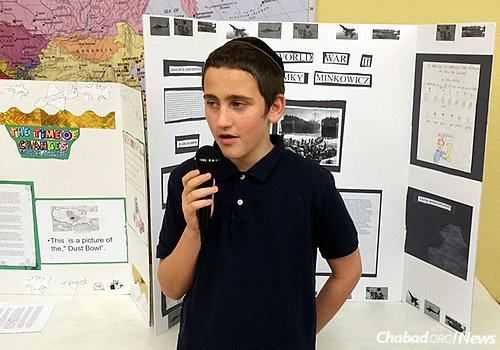 Peretz Meir Simcha Minkowicz, one of the Chabad couple's children, presents his science-fair project.