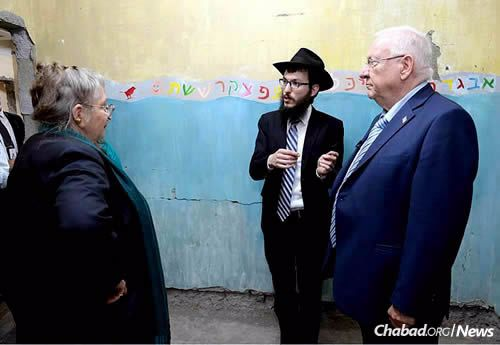 Rabbi Kozlovsky, director of Chabad of Mumbai, shows the Rivlins the devastated remains of the bedroom of the Holtzbergs' young son, Moshe, who was fled to safety during the attack by his Indian nanny. (Photo: Chabad of Mumbai)