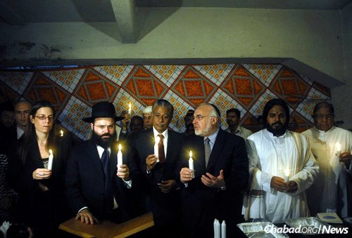A memorial service at the Chabad House in 2009, just one year after the terrorist attacks. From left are: Israeli Consul General Orna Sagiv; Rabbi Avraham Berkowitz, director of the Chabad Mumbai Relief Fund; D. Ramasamy Kaarthikeyan, former director of India's Central Bureau of Investigation; Rabbi Abraham Cooper, associate dean of the Simon Wiesenthal Center; Swami Gnanatej, senior swami at the Art of Living Foundation; and Father Caesar D'Mello, Rector, Cathedral of the Holy Name at Colaba, Mumbai. (Photo: Simon Wiesenthal Center)