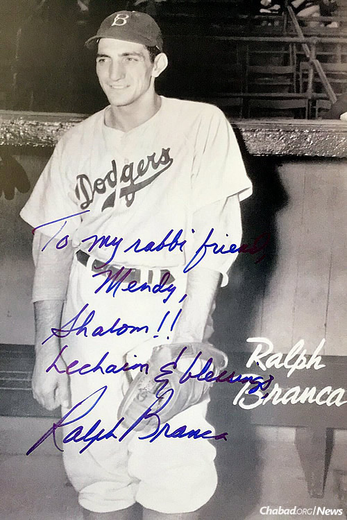 """A signed photo that Branca gave to Chabad yeshivah student Mendy Marlow. It reads: """"To my rabbi friend, Mendy,"""" Branca wrote to one of the Chabad boys after his bar mitzvah. """"Shalom!! Lechaim & blessings, Ralph Branca."""""""