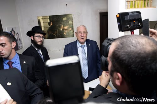 The anniversary of the attacks is marked every year and consistently gets much attention from the press. Here, the rabbi and Rivlin field questions.