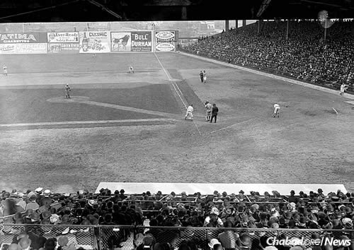 American major league pitcher Ray Caldwell in the first exhibition game at Ebbets Field, the home of the Brooklyn Dodgers, April 5, 1913. The dirt walkway visible between the mound and the plate disappeared after the 1910s. (Photo: Wikimedia Commons)