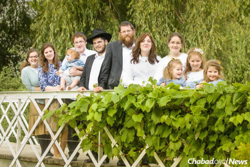 "Rabbi Yitzchok (""Yitzi"") and Rochel Loewenthal, and their nine children."