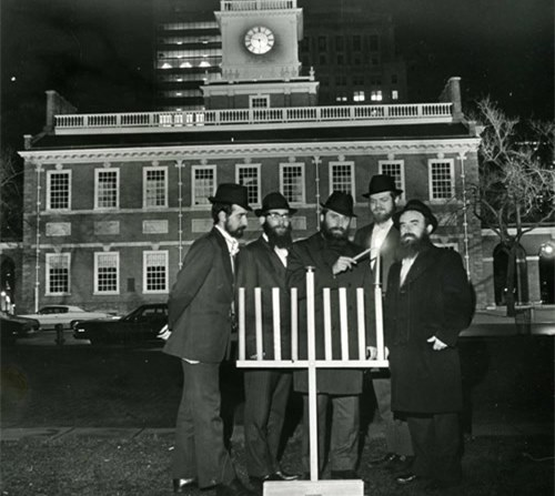 Chabad representative Rabbi Abraham Shemtov (right) and other rabbis light the
