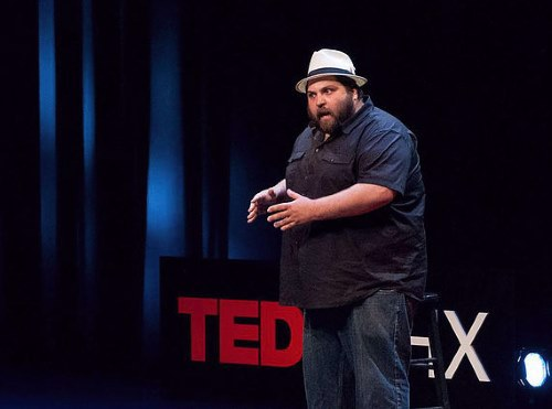 Dany Lobell presenting a TED Talk (provided).
