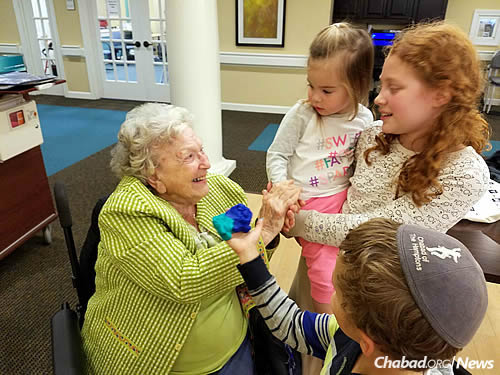 Fifth-grader Amira Sherman, right, enjoys the intergenerational time at the senior center.
