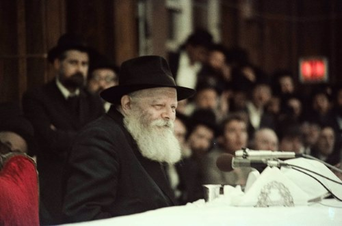 This photo was taken at the first farbrengen led by the Rebbe after suffering a major heart attack. Unbeknownst to most of the audience, doctors were using cardiac monitors to observe the Rebbe's condition throughout the farbrengen.