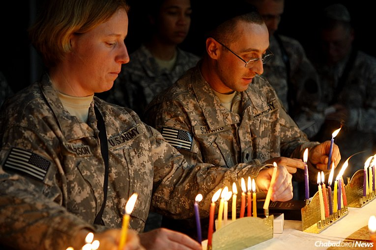 The Aleph Institute has launched an effort asking Jewish day schools and community organizations across the United States to collect Chanukah gifts for children of those serving in the U.S. military, and/or send menorahs, candles, dreidels and chocolate coins directly to military personnel. The drive also applies to children of incarcerated Jewish men and women. (Photo: Courtesy of the Aleph Institute)