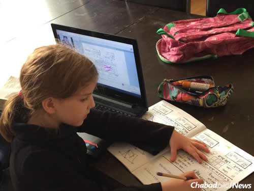 In Copenhagen, as in many Chabad centers around the world, children keep up with their studies and their peers around the world as part of an international online school.
