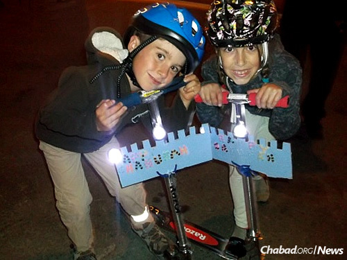 Kids get into Chanukah at the annual bike parade. Potash, with nearly 1,000 Twitter followers, says social media helps draw families to events and programs.