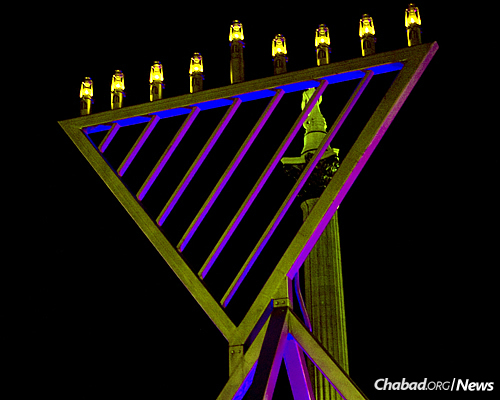 Menorahs will illuminate big cities and small towns on six continents for eight days, from this one in prior years in Trafalgar Square, London …