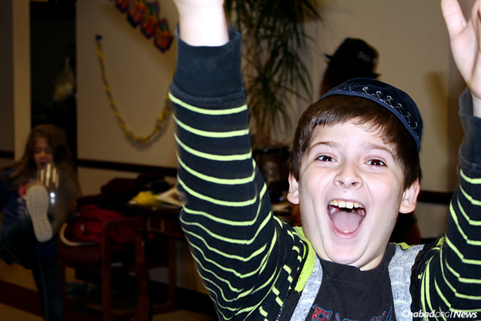 Max Abramson of Wilmington, Del., is ecstatic that he's going to Gan Israel Winter Camp at Chabad Lubavitch of Delaware over school break, where a host of Chanukah-related projects and other activities are on tap for kids. (Photo: Chabad of Delaware)