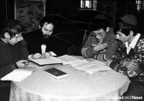 Kaminezki teaches children in the early 1990s.