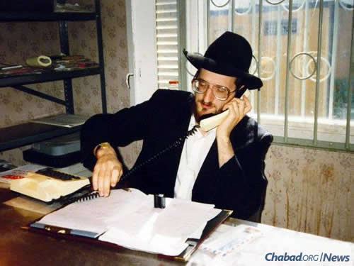 Rabbi Berel Lazar, today the chief rabbi of Russia, works a telephone in an office in the old Marina Roscha synagogue in Moscow, circa 1991. The early 1990s were exceedingly difficult for Lazar and his fellow emissaries; food and other necessities were scarce, and they struggled to raise funds to keep their operations going.