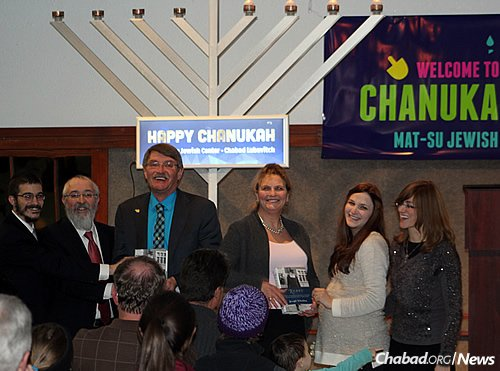At the 2015 Chanukah menorah-lighting and family event are, from left: Rabbi Mendy Greenberg, co-director of the Mat-su Jewish Center Chabad Lubavitch in Wasilla, Alaska, with his father, Rabbi Yosef Greenberg, director of the Lubavitch Jewish Center of Alaska in Anchorage; Mayor of Wasilla Bert Cottle; Mayor of Palmer DeLena Johnson; Chaya Greenberg, co-director of the Wasilla Chabad; and Esther Greenberg, co-director of the Anchorage Chabad.