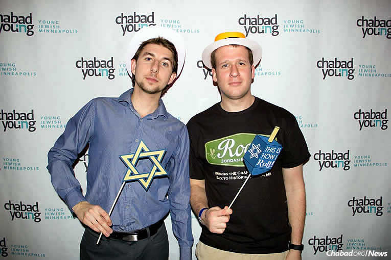 Misha Wahlstrom, left, and Ben Meir have participated in social events and learning with the Chabad Young Professionals group of the Uptown Chabad of Minneapolis, co-directed by Rabbi Sholom and Mushky Brook.
