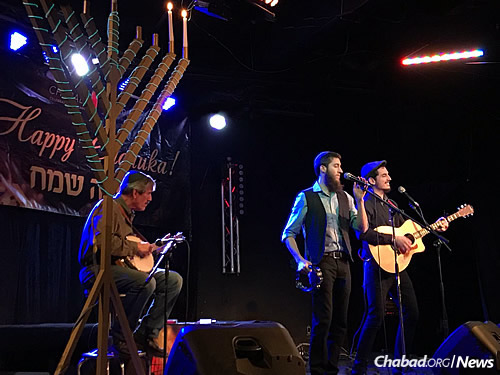 Folk rock band Rogers Park performed Chanukah songs and original compositions.