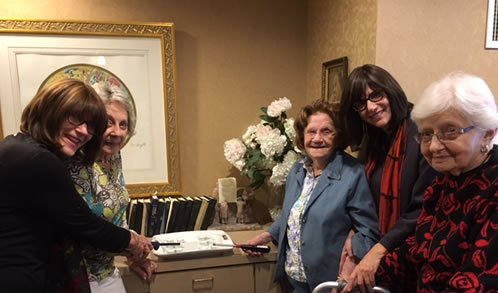 Lieba and her cousin participate in the pre-Shabbat program at the assisted living facility.