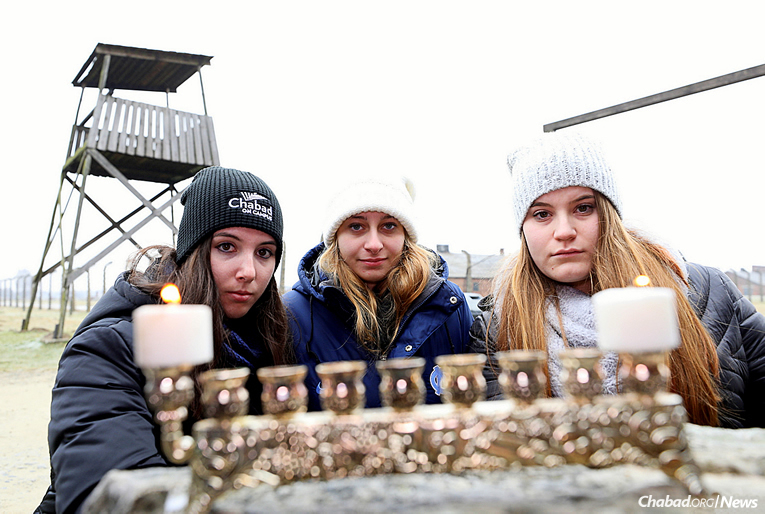 Students from dozens of universities across North America spent six days in Poland as part of Chabad on Campus International's first heritage trip to explore Jewish life there. They lit the first candle of Chanukah in Auschwitz. (Photo: Bentzi Sasson)