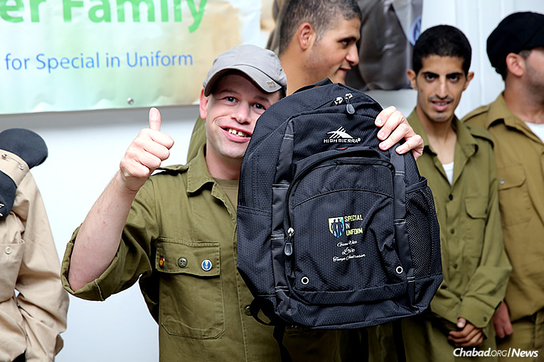 "A total of 250 backpacks were given to soldiers in the ""Special in Uniform"" program of the Israel Defense Forces, thanks to 12-year-old Tanya Andrusier of Bal Harbour, Fla., who sold artwork to raise money for the donation. (Photo courtesy of the Jewish National Fund)"