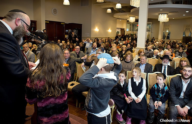 Rabbi Moshe Krasnanski, director of Chabad of the Town in Montreal, with a full house at synagogue in the Beit Ezra Community Center