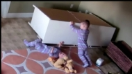 twin-saves-brother-lifts-dresser-video.jpg