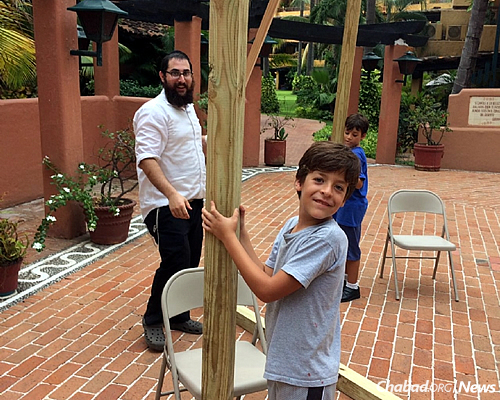 The rabbi gets a little help with putting up and taking down the sukkah.
