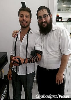 And wrapping tefillin with the locals