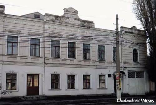"Contemporary view of the old pharmacy on Bolshaya Morskaya Street in Nikolayev, where Rebbetzin Chana hid with her children and neighbors during a 1905 pogrom. ""It was remarkable to see how he walked around quieting the children,"" wrote Rebbetzin Chana of her son, the Rebbe, who was 3 at the time. ""It was too dangerous to talk, lest the voices be heard outside; he gestured with his little hands to keep quiet, calming each child in a different manner."" (Photo: Jewish Educational Media/Early Years)"