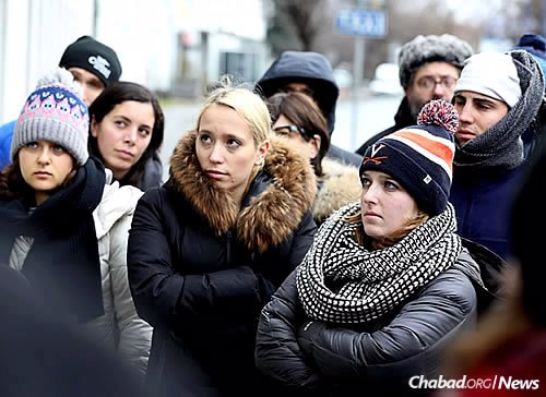 Sydney Persing , 20, center, with other students on a Chabad-sponsored trip to Poland in December. (Photo: Bentzi Sasson, Chabad.edu)