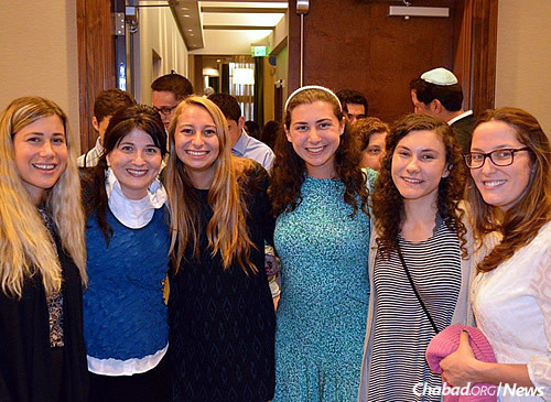 Students before Rosh Hashanah services with Yehudis Bluming, second from left.