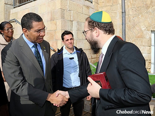 """Said Holness: """"I believe that in building strong economies, we can build a peaceful world."""""""