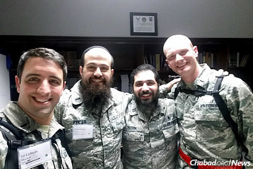 From left: Lt. Swift, Pekar, Chabad chaplain Rabbi Elie Estrin, Lt. Moll