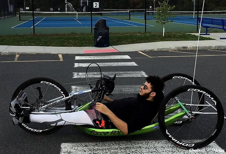 """Joseph Volfman will participate in the Jan. 29 Miami Marathon using a recumbent hand-cycle. Part of """"Team Friendship,"""" he will be raising money for Friendship Circle of New Jersey, the local branch of the international Chabad-affiliated organization."""