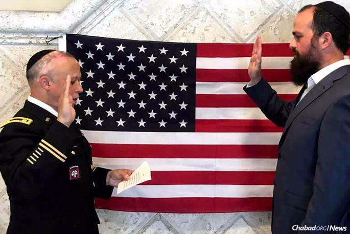 Rabbi Levy Pekar gets sworn in to the U.S. Air Force by U.S. Army Chaplain (Lt. Col.) Rabbi Shmuel Felzenberg, left, of the Office of the Chief of Chaplains, on July 12, 2016. Currently, Pekar, 29, is in basic training at Maxwell Air Force Base in Montgomery, Ala.