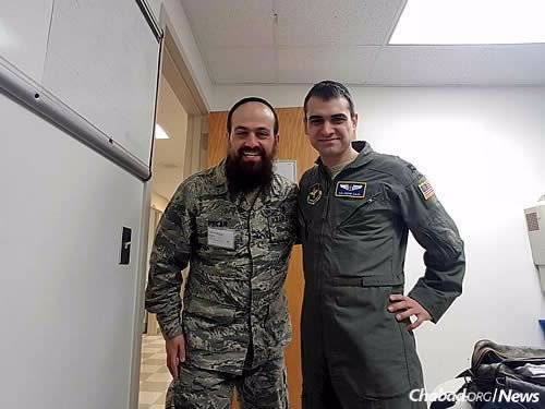 With Dr. Solomon Saul, a Chabad-Lubavitch flight surgeon whose family has helped provide Pekar with food on the training base